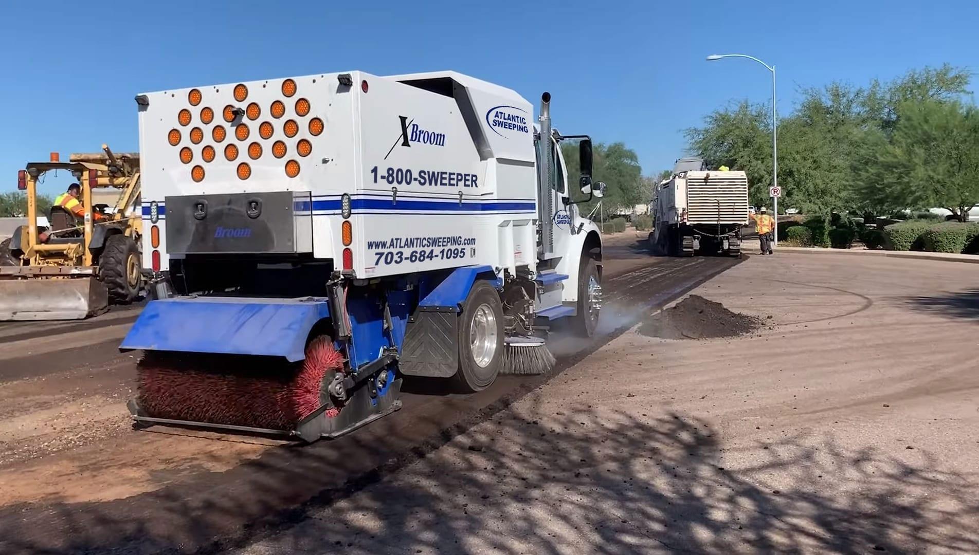 Sweeper Trucks: What Are They & Why Do I Need One?